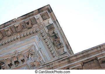detail of upper details of a antique federal building