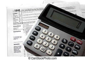 Federal Taxes - a federal tax form with a calculator sitting...