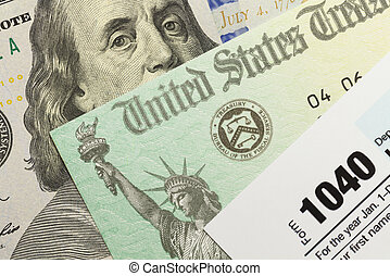 Federal Taxes - 1040 Tax Form with Refund Check and Cash.