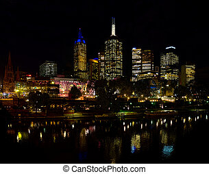 Federation square in Melbourne at night reflected in the Yarra