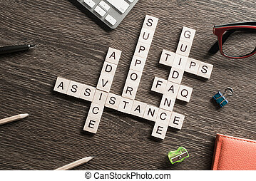 Feedback assistance support guidance words spelled with cubes on wooden table