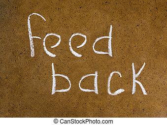 feedback handwritten inscription in chalk on a plain background