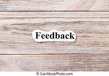 Feedback of the word on paper. concept. Words of Feedback on a wooden background