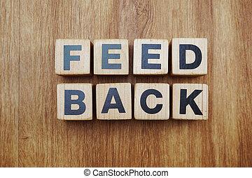 feedback word alphabet letter on wooden background