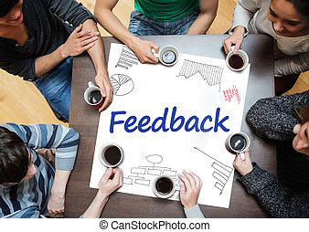 Feedback written on a poster with drawings of charts during...