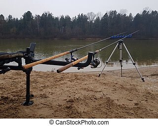 Feeder fishing on the river. Wet fishing tackle, reel and rod. Fishing for carp and other fish. Fisherman's workplace