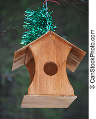 feeder for birds in the forest