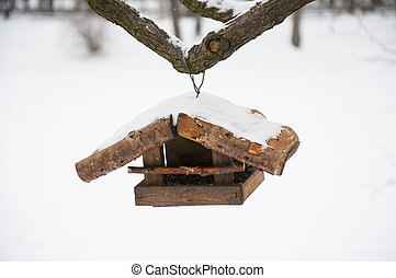 Feeder for birds on the tree