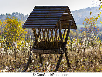 Feeder for deer standing in themidddle of the rural...