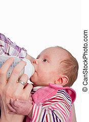 Feeding Baby eating milk from the bottle