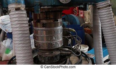 Feeding plastic from hopper into barrel of extruder -...
