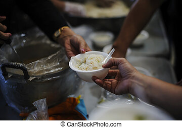 Feeding the poor to hands of a beggar. Poverty concept