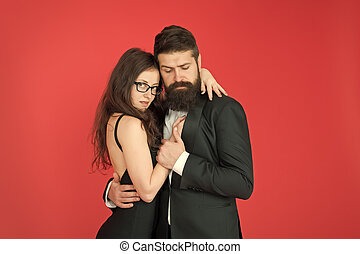 Feel rhythm of heart. Happy together. Man in tuxedo and woman black dress dancing at party. Passionate couple dancing. Lets dance tonight. Elegant couple in love tender hug dancing red background