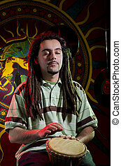 Feel the music - Young rastaman performing on the stage