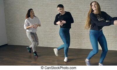 Feel the Rhythm - Shaky camera of three girls performing...