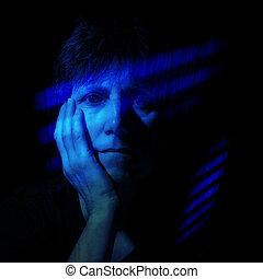 Feeling blue - older women in blue shafts of light effect