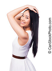 Feeling flirty. Side view of beautiful young Asian woman in...