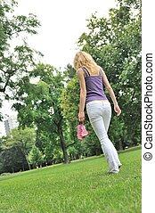 Feeling free - walking barefoot in park