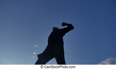 Feeling like a winner Silhouette hand up of man pumping his fist in lifestyle the air. man victory businessman concept