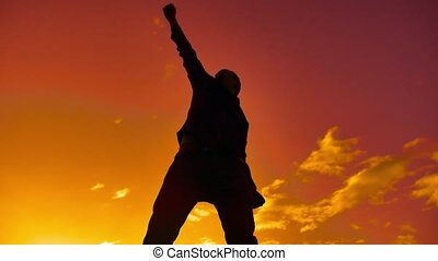 Feeling like a winner Silhouette hand up of man pumping his fist in the air. man victory businessman concept lifestyle