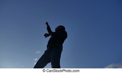 Feeling like a winner Silhouette hand up of man pumping his lifestyle fist in the air. man victory businessman concept
