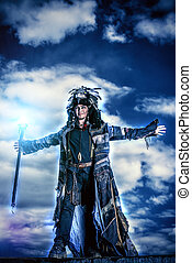 feeling of glory - Portrait of a shaman dancing over cloudy...