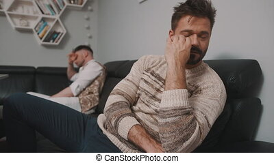 Feeling offended. Gay couple having an argument. Ups and downs in relationship