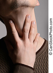 Feeling pain. Cropped image of men touching his neck while...