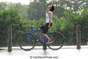 feeling  rain - girl enjoying the rain