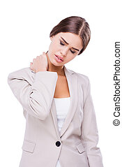 Feeling terrible pain. Depressed young businesswoman touching her neck and keeping eyes closed while standing against white background
