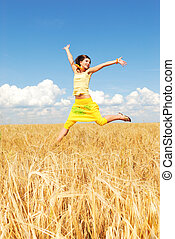 Feeling the freedom - Beautiful girl in a wheat field