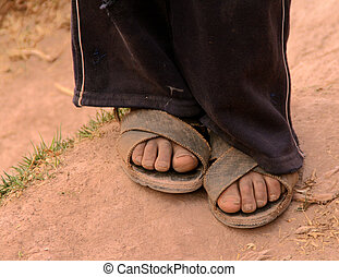 feet and shoes of children in school in south america