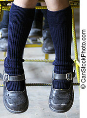 feet and shoes of children in school