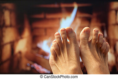 Feet are heated by a fireplace