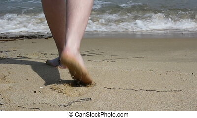 Feet are on the beach to the sea on