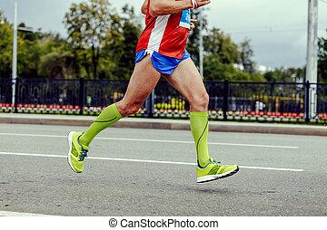 1c453aa6d feet athlete running. feet athlete running city marathon in green  compression socks