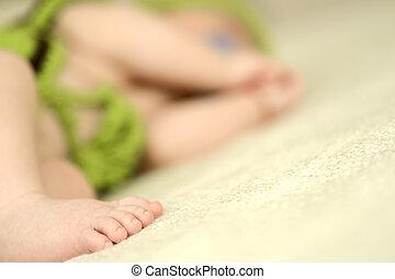 Feet baby sleeping in crib