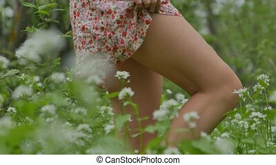 feet close up the girl in blossoming grass sexy