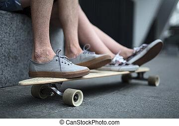 Feet couple of teenagers on the longboard closeup - Feet...