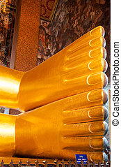 Feet detail of Reclining Buddha gold statue in Wat Pho buddhist temple, Bangkok, Thailand
