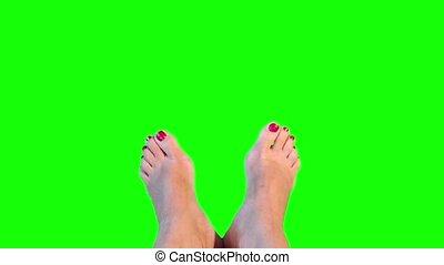 Feet girl. Camera moves.