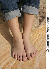 Holiday feet on a pattern of sandstone