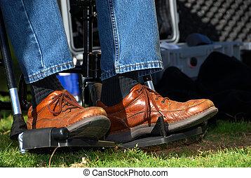 Feet in a Wheelchair - A man\\\'s feet in brown leather...