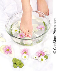 Feet in aromatherapy bowl - Feet dipped in aromatherapy bowl