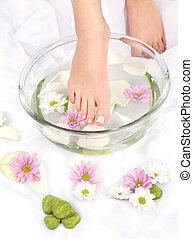 Feet in aromatherapy bowl - Feet dipped in aromatherapy bowl