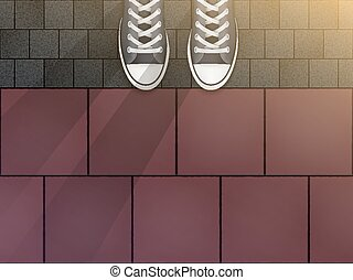 Feet in sneakers on cobblestone pavers