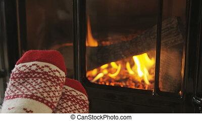 Feet In Warm Socks By Fireplace In Winter Having a Cozy Time...