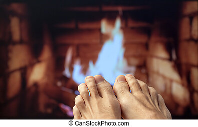 Feet legs are heated by a fireplace