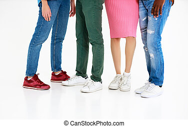 feet legs of a group of people on white background
