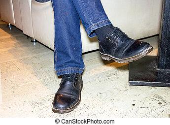 Feet men in black boots